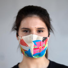 Load image into Gallery viewer, Uma's Mask art print fabric mask, on face, front view.