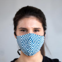 Load image into Gallery viewer, Blue Chevron art print fabric mask, on face, front view.