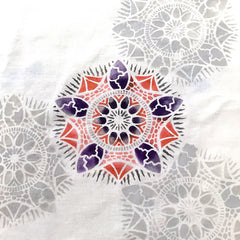 Mandala stencil by April Sproule painted on fabric.