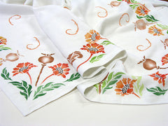 This linen tablecloth is hand painted with the Poppy Stencil by Sproule Studios.