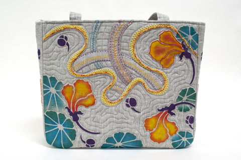 A hand painted and embroidered linen bag using the Nasturtium Stencil by Sproule Studios.