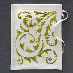 Here the Springtime Stencil from Sproule Studios is hand painted on a linen pouch.
