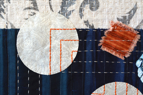 Hand stitching paper to fabric by April Sproule