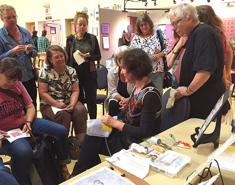 April Sproule giving a demo at a textile event.