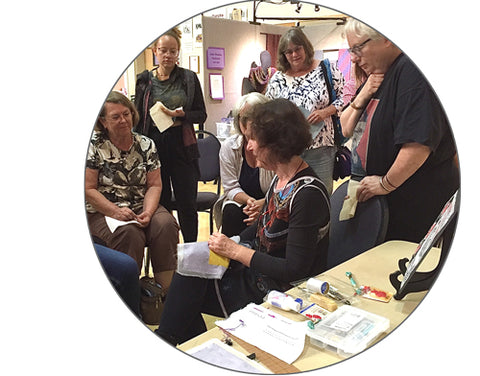 April Sproule doing a demonstration of her textile art techniques.