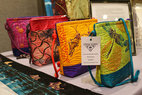 A collection of small hand dyed and printed bags by April Sproule.