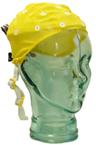 Small yellow EEG cap on glass head
