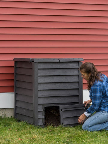 A woman working on her composter