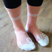 Pink socks with LOVE writing