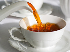 Pouring tea into a cup