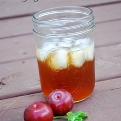 Plum tea in a mason jar