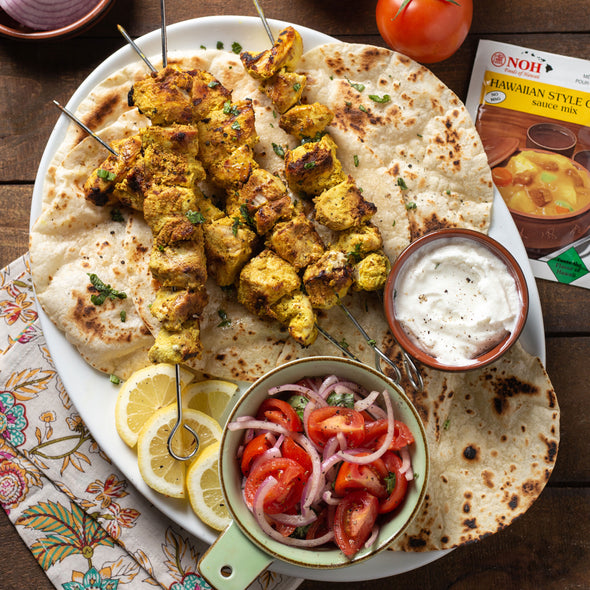 Hawiian chicken curry skewers with naan bread