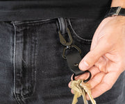 Hooks onto belt loops or straps for easy access