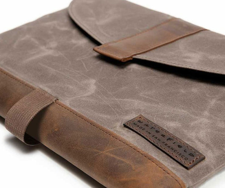 Waxed Canvas with full-grain leather accents
