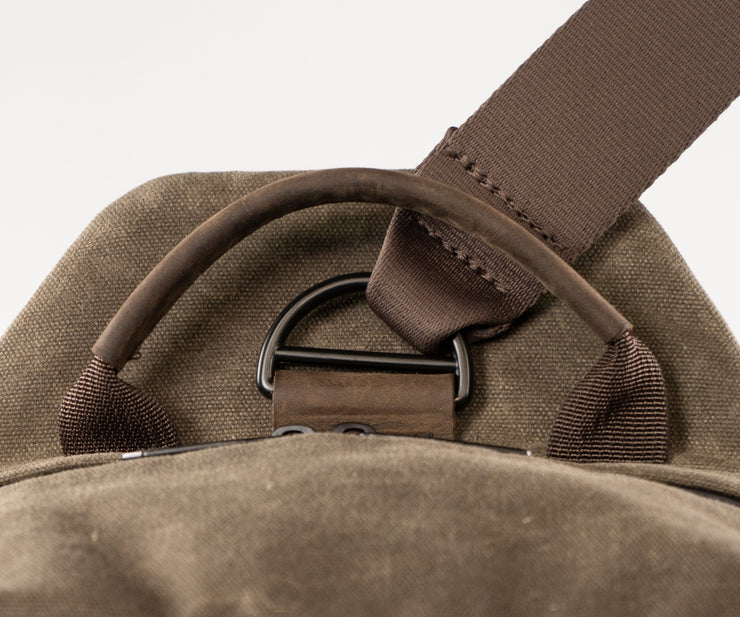 The Sling strap pivots  to keep it steady on your back