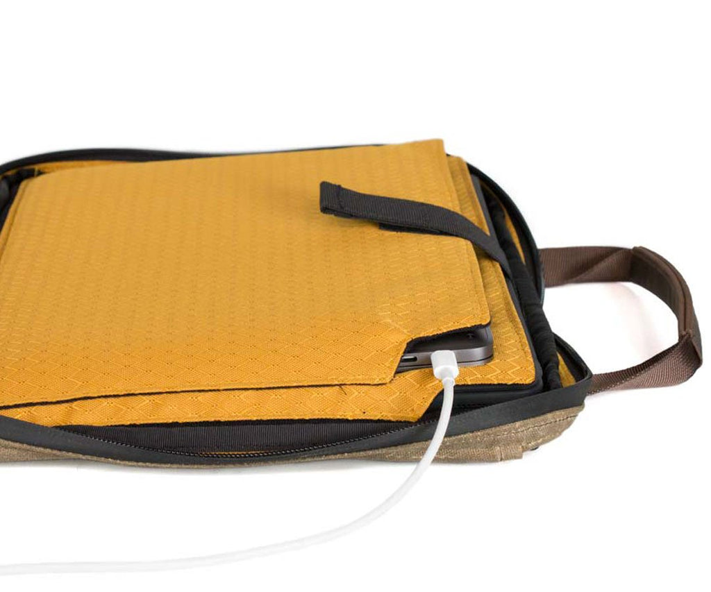Charge the laptop while in its case