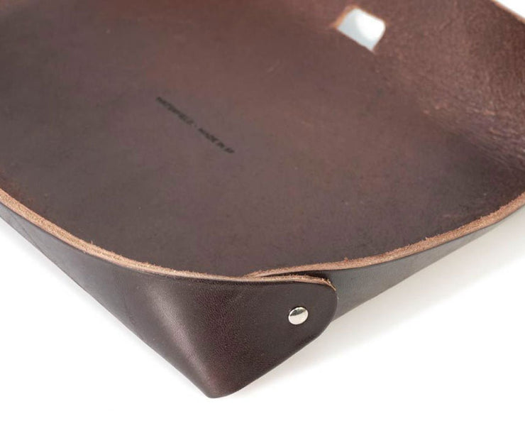 Genuine, premium full grain leather with metal rivets