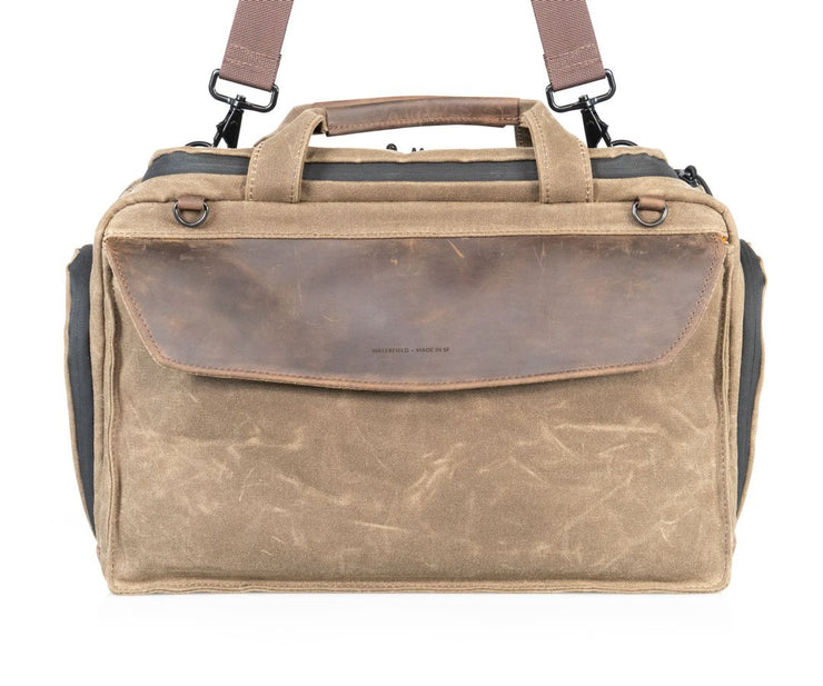 Includes removable, adjustable shoulder strap