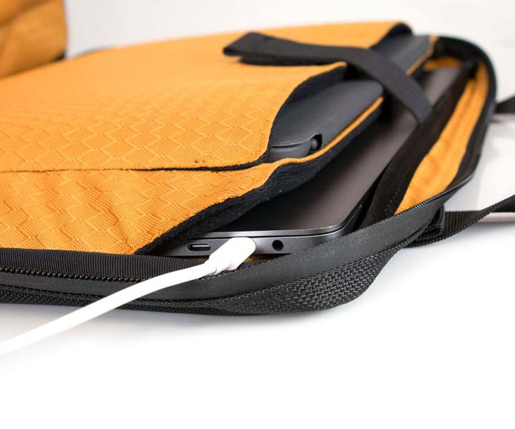 Padded pockets for laptop & tablet. In-case charging.