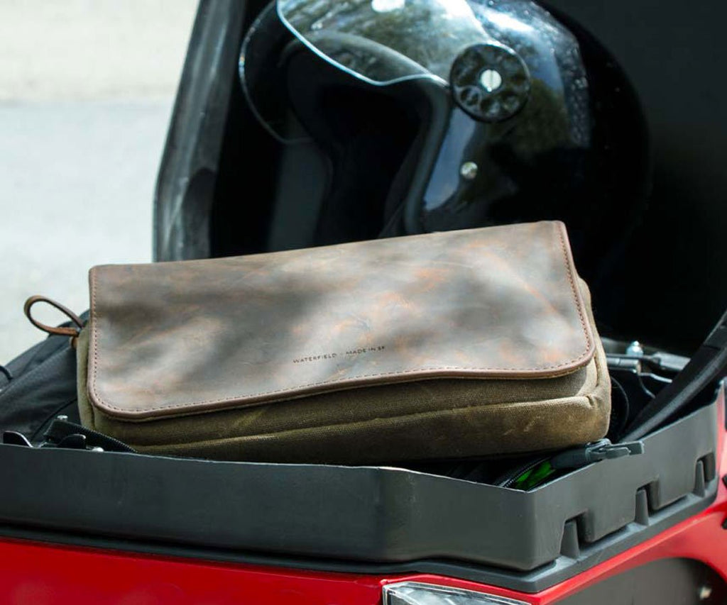 Organizes items in motorcycle glove box
