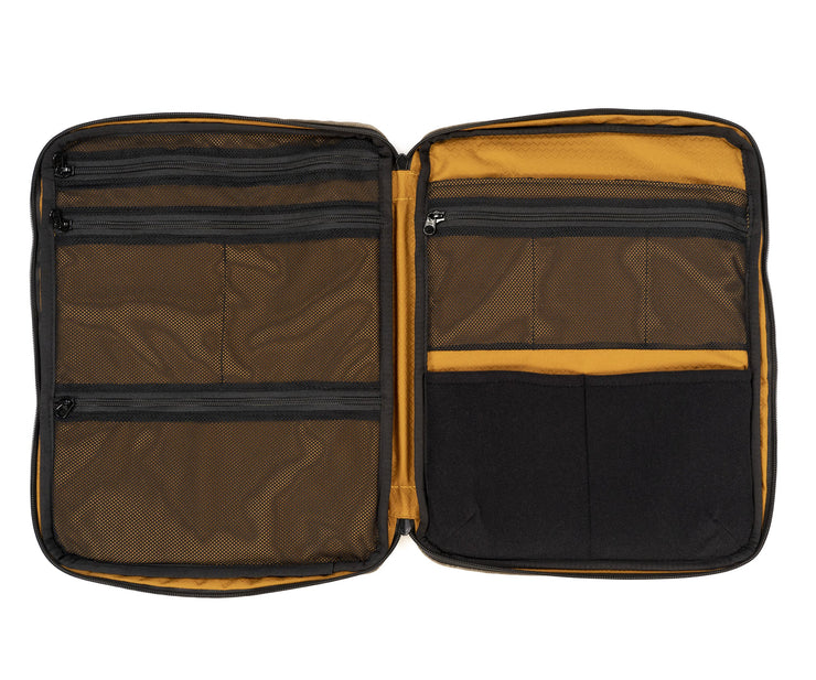 Opens flat for easy packing. Zipped mesh pockets for visibiity and security.