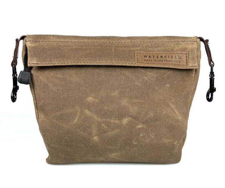 The PiggyBack for accessories comes in Waxed Canvas and Ballistic Nylon