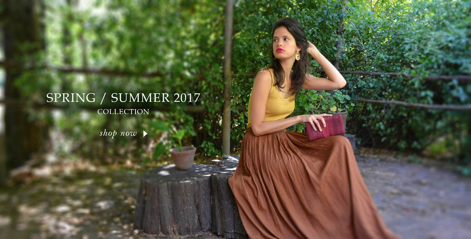 Spring Summer 2017 sustainable luxury handbag clutch collection with model in nature environment