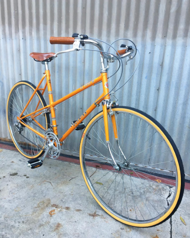 Schwinn Le Tour Step-Through Mixte Style City Bike in Miracle Tangerine Mango Color