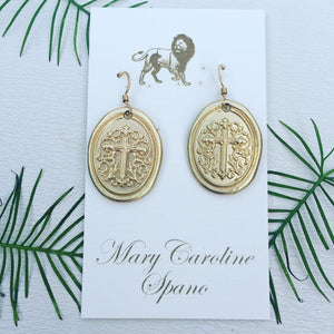 Oval Gold Tone Cross Charm Earrings