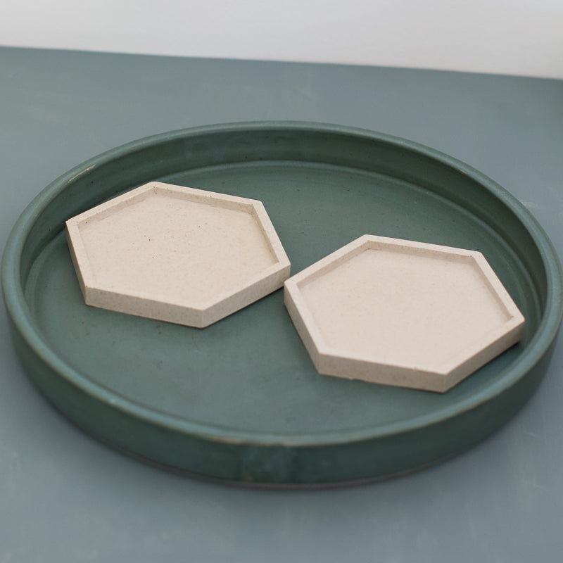 neutral hexagonal coaster made with ground coffee by pigment and razzo