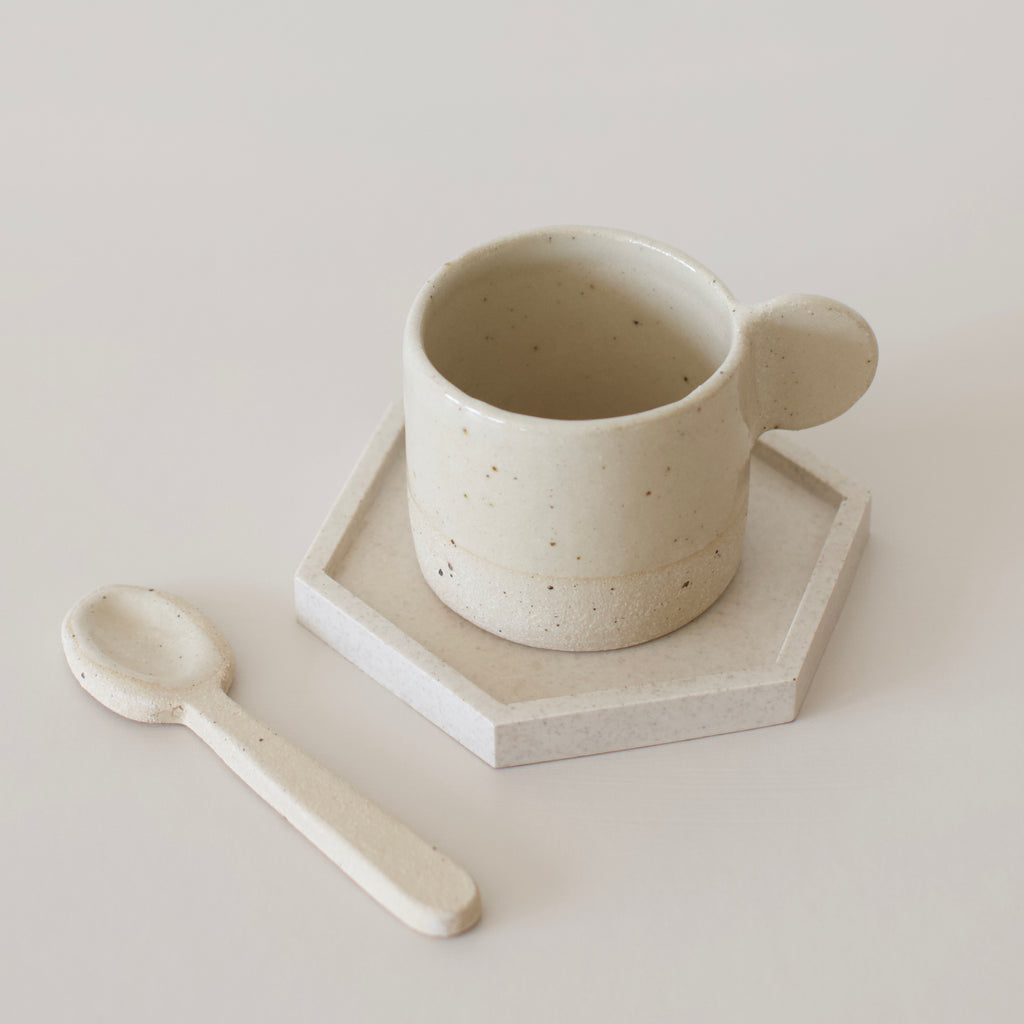 ceramic mug with a minimal handle glazed with a neutral slip by the super sparrow