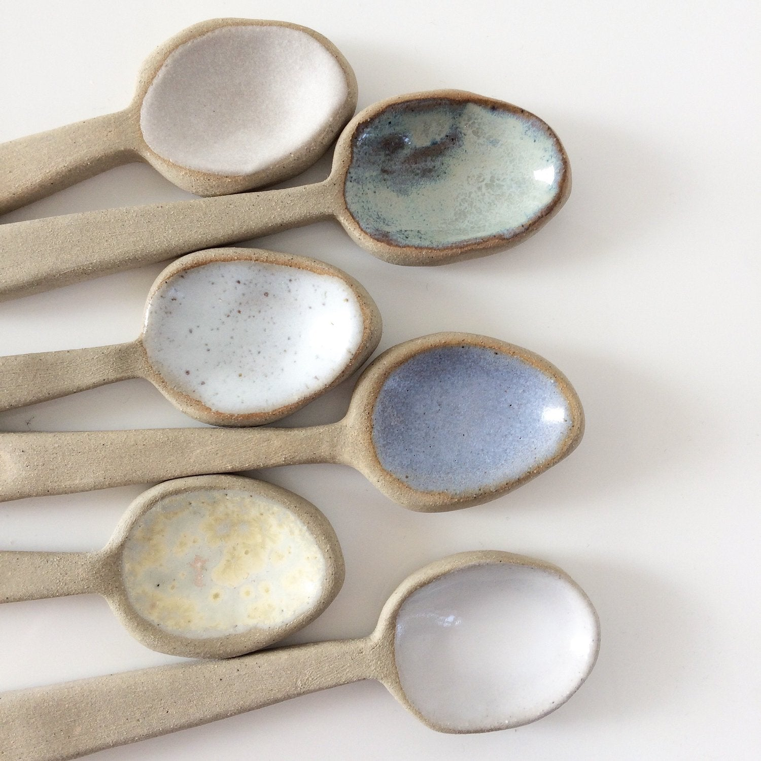 cute tea spoons made with ceramic and glazed by the super sparrow