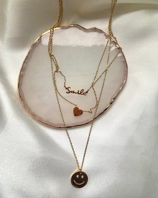 Happy face gold necklace