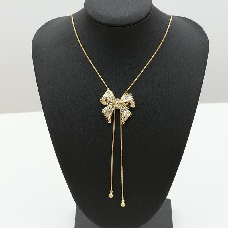 Holiday Joy Crystal Bow Lariat Necklace Necklace elliesage Gold