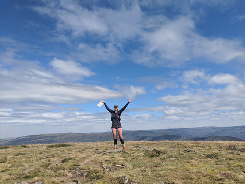 FOHER Co Ambassador Philadelphia Holmes standing on the top of Mt Bogong on a 50km run in the Victorian High Country.