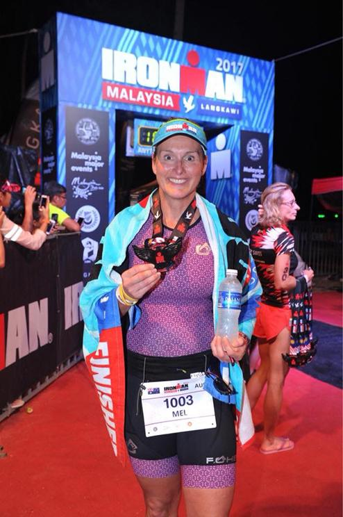 IRONMAN Mel completing IRONMAN Malaysia
