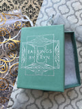 Photo of sage green gift box on wrapping paper