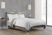 neatly made bed with luxury stone grey and white organic cotton bedding set