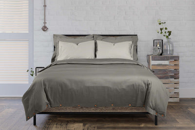 double bed made up with stone grey hotel style organic cotton bedding