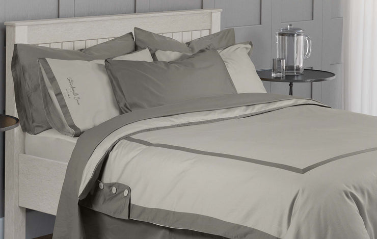 close up of stone grey hotel quality bedding on neatly made bed