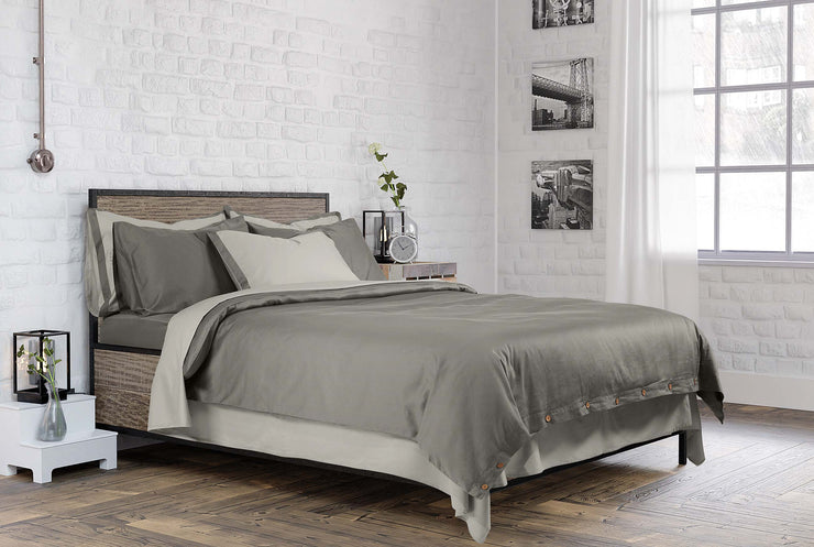 neatly made bed with luxury stone grey bedding set made from organic cotton