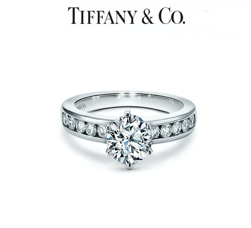 The Tiffany Setting Engagement Ring with a Channel-set Diamond Band in Platinum