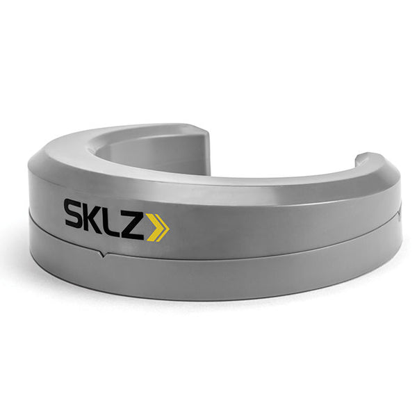 Side view of silver putting pocket trainer with SKLZ logo on front