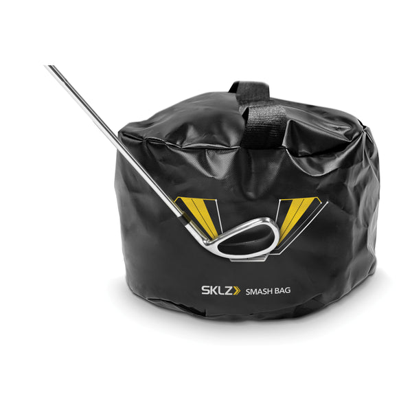 Golf club touching front of black golf training bag