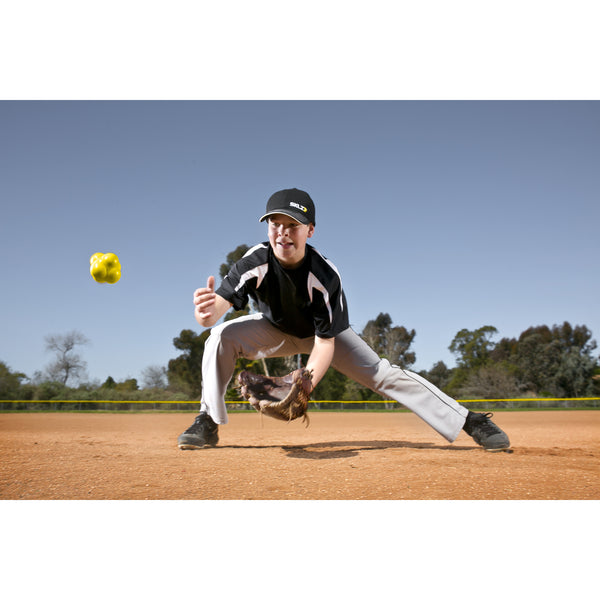 Young boy practicing with SKLZ reaction baseball