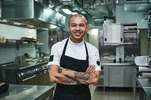 Smiling chef standing in a kitchen