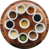 An assortment of sauces in individual dishes