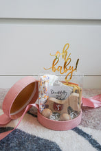 Load image into Gallery viewer, Pink Baby Shower Ribbon Round Box with Customised Initial Wooden Toy, Headbands and Cotton Bibs