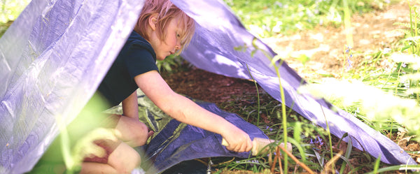 boy builds a purple den