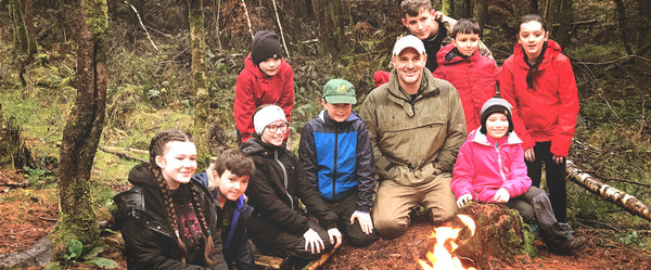 First man Out Ed Stafford teaching children bushcraft skills at Forest Holidays